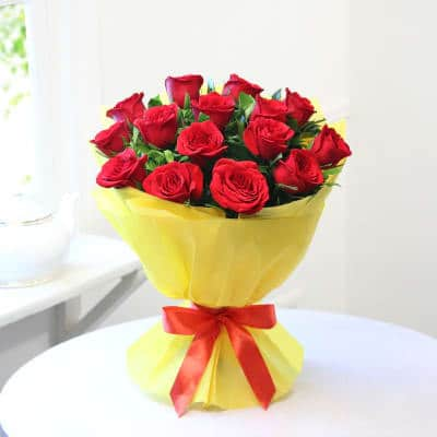 Roses with Yellow Hug - SendFlowers.pk